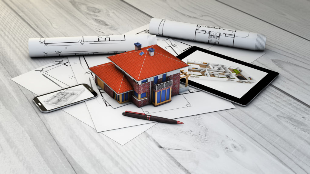 real estate, architecture or interior design concept: digital generated devices and house mock-up with plots
